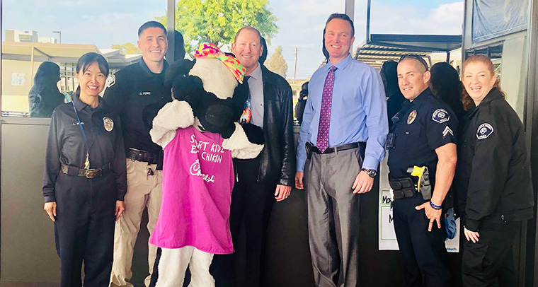 Principal with Buena Park Police officers and Millie Moo